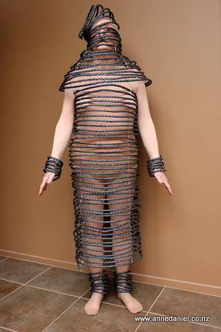 "Anne Daniel modelling her creation ""Helical"" made out of plaited plastic strapping tape"